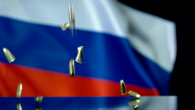 russian flag behind bullets falling in slow motion - russian flag stock videos & royalty-free footage