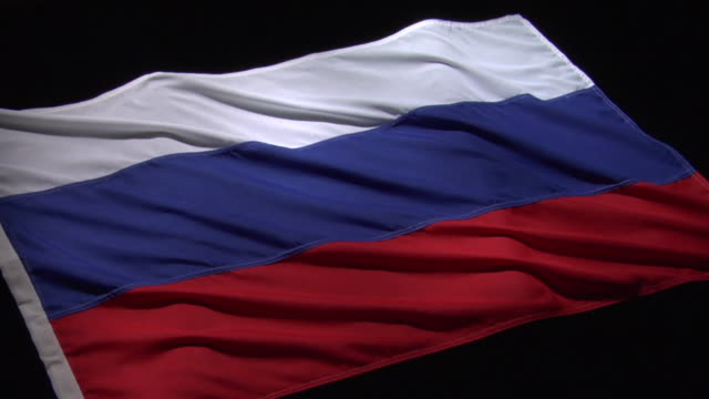 cu, pan, russian flag on black background - russian flag stock videos & royalty-free footage