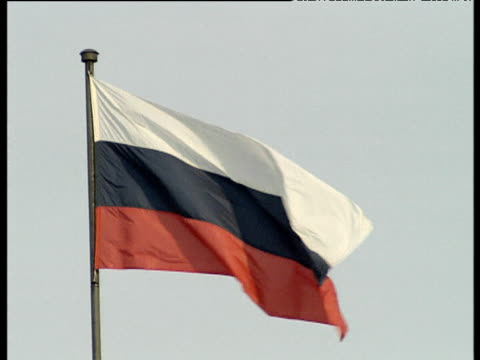 russian flag on pole flapping in breeze against grey sky st petersburg - russian flag stock videos & royalty-free footage