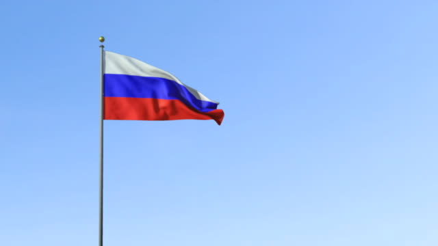 ws, russian flag waving against blue sky - russian flag stock videos & royalty-free footage