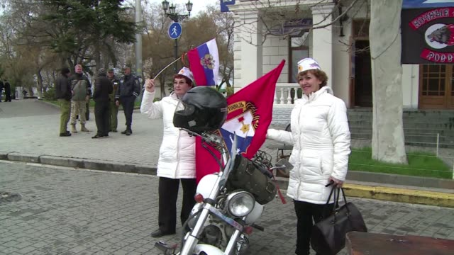 russian flags were flying high in the historic naval city of sevastopol sunday as people looked forward to rejoining what many see as their homeland... - sevastopol crimea stock videos and b-roll footage