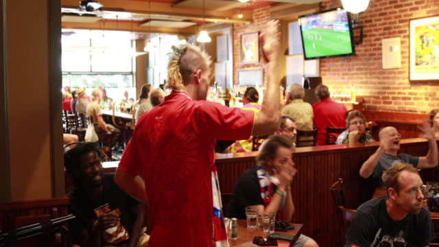 russian football fan pavel abramov reacts while watching the 2018 world cup game against croatia at the uptown cafe russian lost to croatia 43 in... - international team soccer stock videos & royalty-free footage