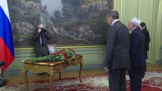 russian foreign minister sergei lavrov and iranian foreign minister mohammad javad zarif lay flowers next to a portrait of murdered russian... - assassination of andrei karlov stock videos & royalty-free footage