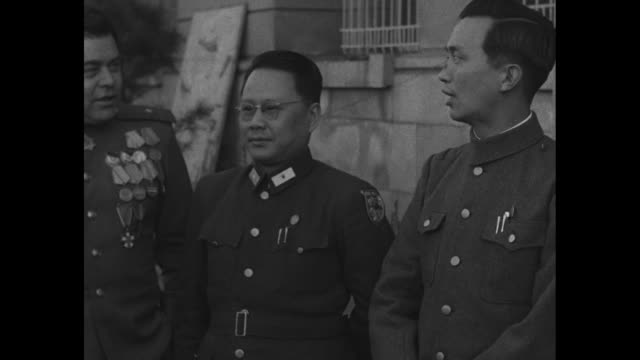 russian general andrei kovtun-stankevich posing for photo opportunity with two chinese officers in shenyang as soviet occupation ends / note: exact... - manchuria stock videos & royalty-free footage