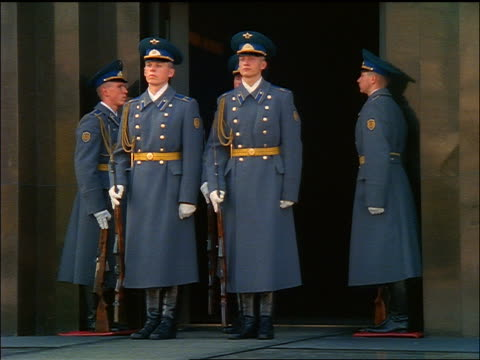 PAN 3 Russian guards marching down steps of Lenin's tomb / Moscow