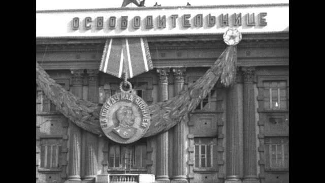 russian headquarters in mukden decorated with huge facsimile of russian medal with likeness of joseph stalin / major general andrei kovtunstankevich... - 将校点の映像素材/bロール