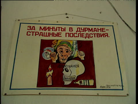 russian language anti drugs poster in rehabilitation centre tajikistan - poster stock videos & royalty-free footage