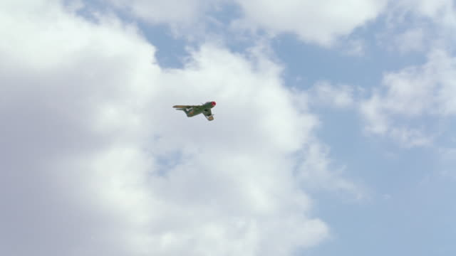 a russian mig fighter jet flies through the sky. - fighter stock videos & royalty-free footage