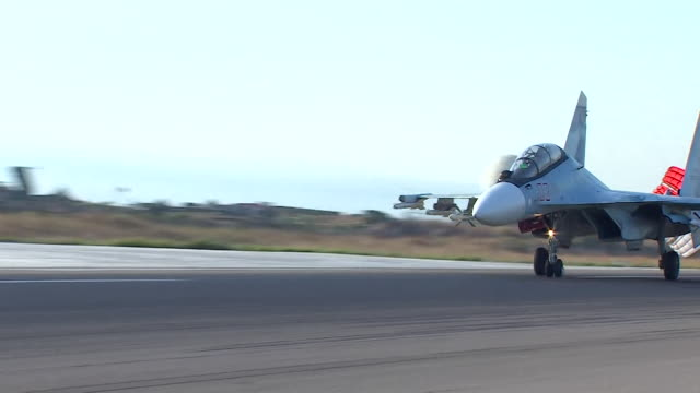 Russian military aircraft taking off from an air base in Syria