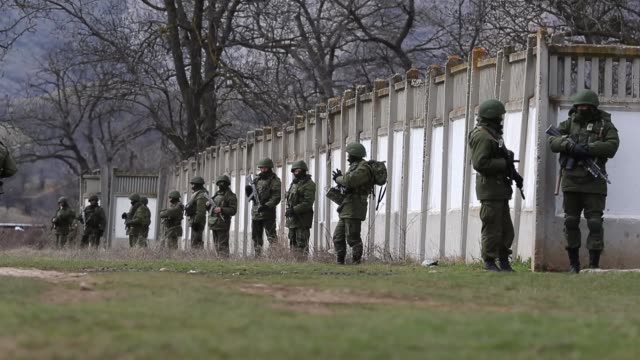 ws russian military personnel surround a ukrainian military base on march 19 2014 in perevalnoe ukraine russia's constitutional court ruled... - vladimir russia stock videos and b-roll footage