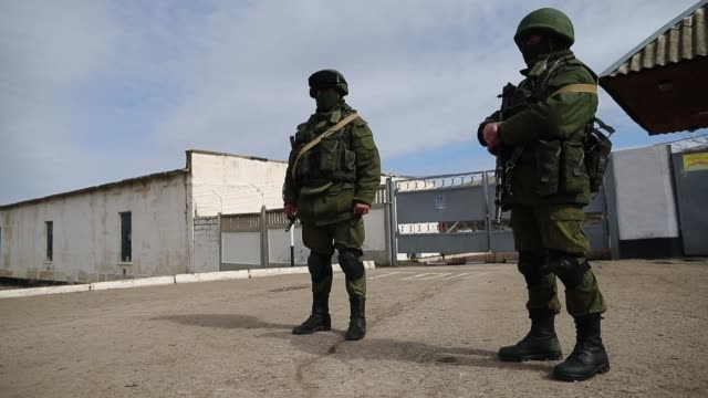 russian military personnel surround a ukrainian military base on march 19, 2014 in perevalnoe, ukraine. russia's constitutional court ruled... - military base stock videos & royalty-free footage