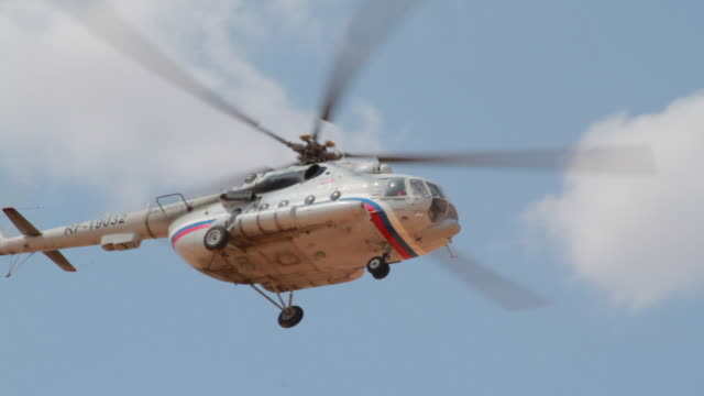 russian military transport helicopter mi-8 flying over the head, russia - helicopter stock videos and b-roll footage