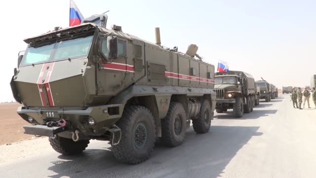 russian military vehicles drive on the road as russia makes a new military and logistic reinforcement of 30 vehicles to its military points in... - ryssland bildbanksvideor och videomaterial från bakom kulisserna