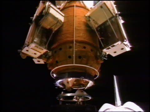 russian mir space station docking with atlantis space shuttle / sts76 - space exploration stock videos & royalty-free footage
