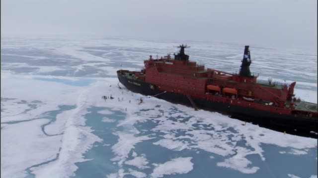 low aerial, russian nuclear icebreaker in partially frozen sea, russia - clima polare video stock e b–roll