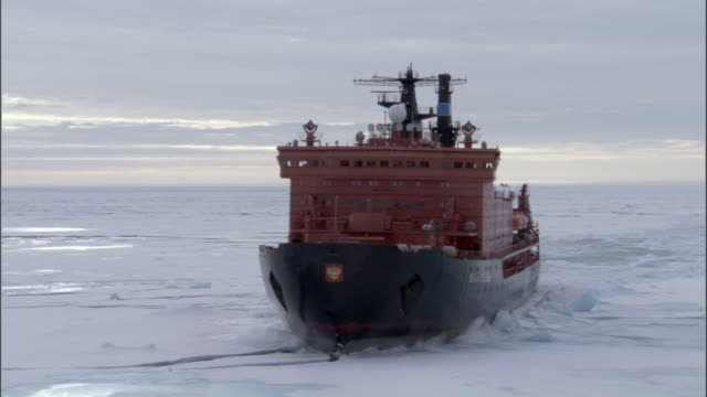 WS, Russian nuclear icebreaker traveling through frozen sea Russia
