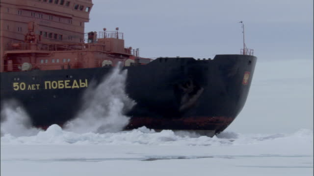ms, russian nuclear icebreaker traveling through frozen sea russia - cyrillic script stock videos & royalty-free footage