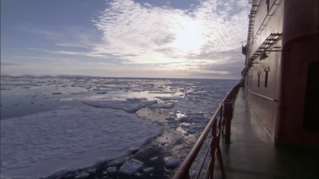 REAR POV, Russian nuclear icebreaker traveling through ice covered ocean, Russia