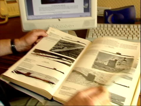 stockvideo's en b-roll-footage met russian nuclear submarine sinks in barents sea; england: commander paddy ryan sitting looking at submarine book and interview sot - sub will be safe... - russia