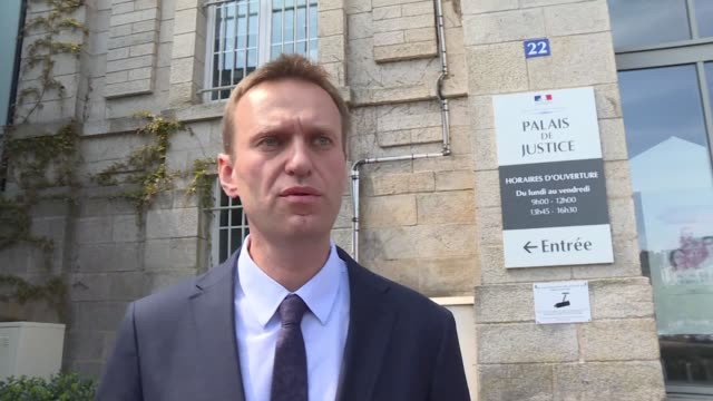 Russian opposition leader Alexei Navalny tells a French judge he sought real and fair justice with a lawsuit against French cosmetics firm Yves...