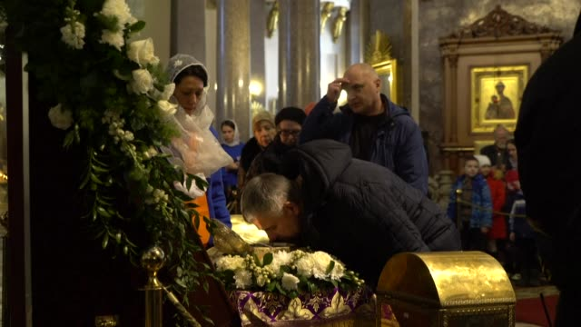 russian orthodox believers kiss the relics of john the baptist in the kazan cathedral in central saint petersburg despite health advisories issued to... - baptist stock videos & royalty-free footage