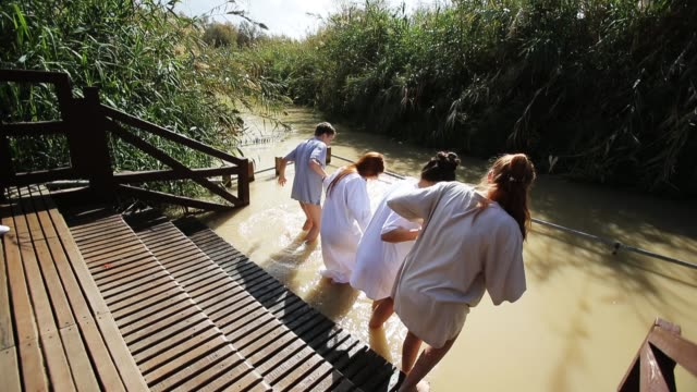 russian orthodox christian pilgrims get baptized in the waters of the eastern bank of the jordan river on january 19 2018 in tal elkharrar jordan... - religious celebration stock videos & royalty-free footage