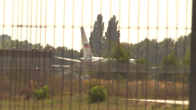a russian plane is seen ahead of a prisoner exchange between russia and ukraine at the boryspil international airport near kiev ukraine on 07... - political prisoner stock videos & royalty-free footage
