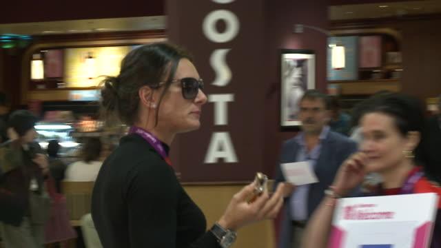 Russian pole vaulter Yelena Isinbayeva arrives at Heathrow for London 2012 Olympics Eats chocolate bar and briefly waves at camera