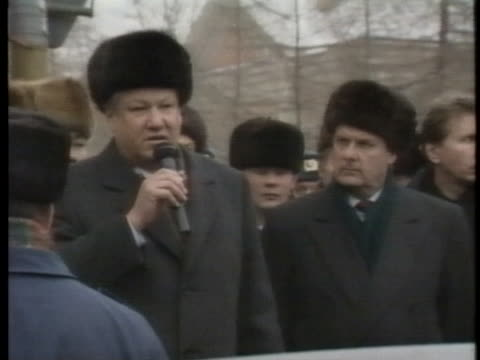 russian president boris yeltsin emerges from a st. petersburg building to speak to a crowd, and an angry man yells at him; two men confer nearby. - caucasian appearance stock videos & royalty-free footage