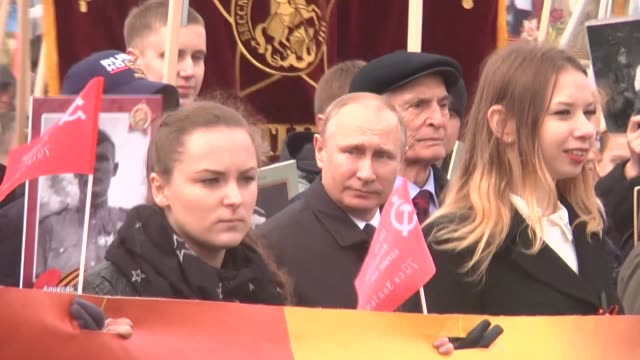 russian president vladimir putin carries a portrait of his father as he takes part in immortal regiment march along with thousands of people carrying... - wladimir putin stock-videos und b-roll-filmmaterial
