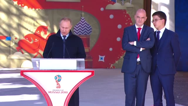 russian president vladimir putin delivers a speech next to fifa president gianni infantino deuring a ceremony to launch the volunteer programme for... - gianni infantino stock videos and b-roll footage