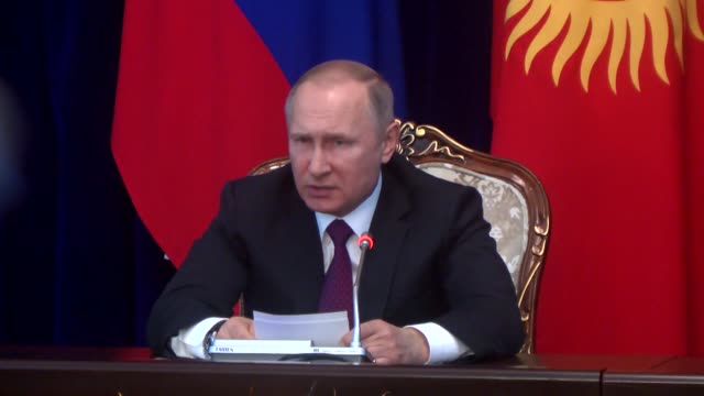 Russian President Vladimir Putin holds a joint press conference with his Kyrgyz counterpart Almazbek Atambayev in Bishkek Kyrgyzstan on February 28...