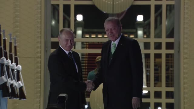Russian President Vladimir Putin is welcomed by Turkish President Recep Tayyip Erdogan with an official welcoming ceremony prior to a meeting on...