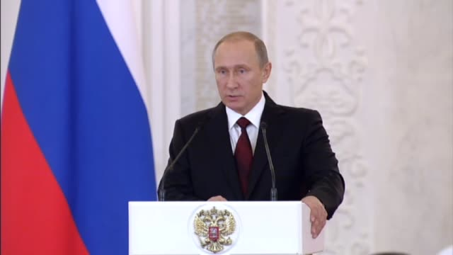 Russian President Vladimir Putin speaks during a ceremony of presenting Russian state decorations to foreign citizens for their particular...