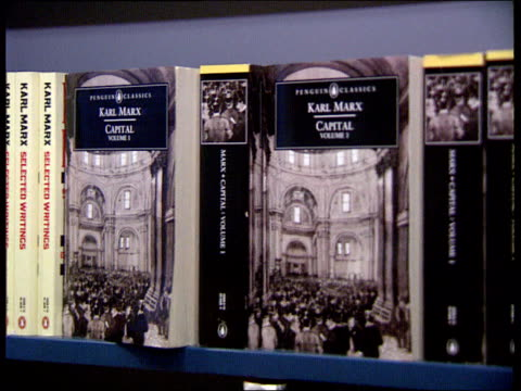 """russian price increases; england london lacms copies of books on marxism on bookshelf in shop pull out copies of karl marx's """"capital"""" on shelf pull... - book shop stock videos & royalty-free footage"""