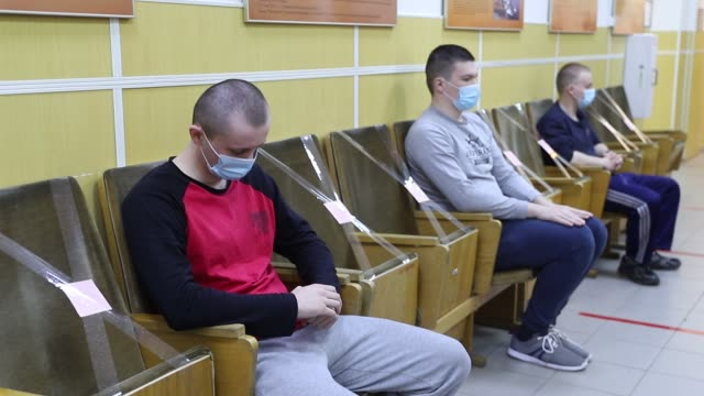 stockvideo's en b-roll-footage met russian recruits wearing face masks as a protective measure at the recruitment center on on may 20, 2020 in saint petersburg, russia. russian... - military recruit