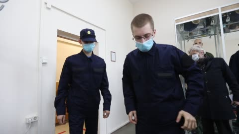 stockvideo's en b-roll-footage met russian recruits wearing face masks as a protective measure puts on their military uniform at the recruitment center on on may 20, 2020 in saint... - military recruit