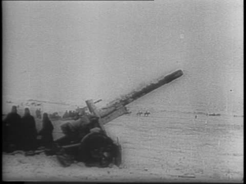 Russian Red Army Winter Offensive / Russian Stormavik dive bombers strafe miles of Nazi supply train / thousands of Nazi prisoners taken / artillery...