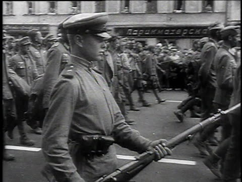 russian solders guarding german pows marching through the streets of moscow / moscow russia - guarding stock videos & royalty-free footage