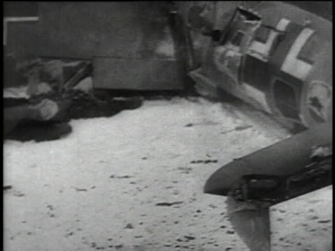 russian soldier examines german pilot's identification card / wreckage of german airplane / dead german pilot lying in snow / russian troops picking... - 1941 stock-videos und b-roll-filmmaterial