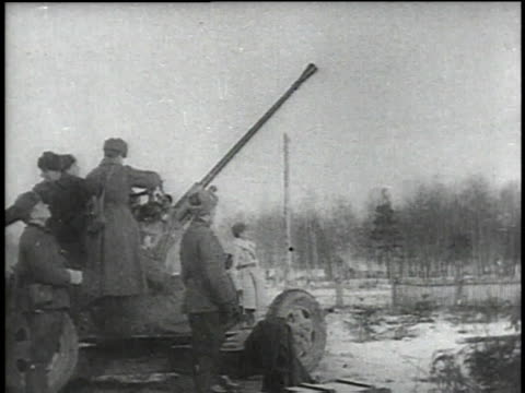 russian soldier looking through binoculars / soldiers firing anti-aircraft gun with elevated barrel / gun firing / shells being loaded into gun /... - 1941 stock videos & royalty-free footage