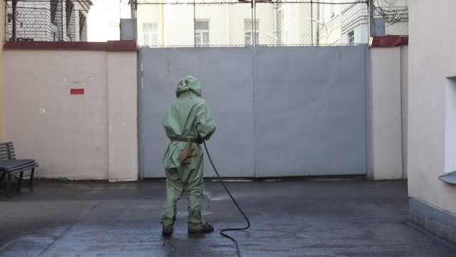 stockvideo's en b-roll-footage met russian soldier wearing protective suits disinfects yard of the recruitment center on on may 20 2020 in saint petersburg russia russian president... - military recruit