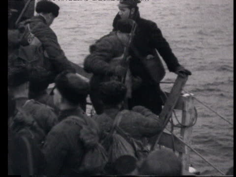russian soldiers board landing boats from battleship, cannons being loaded on warship, soldiers, soldiers reading propaganda letter, soldier holding... - 1898 stock videos & royalty-free footage