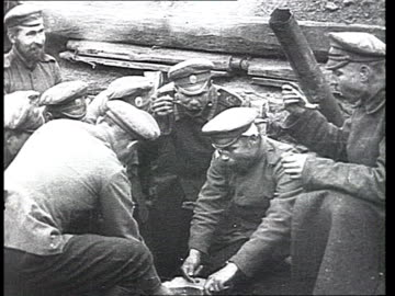russian soldiers' everyday life at the front , eating, resting : group of russian soldiers eating soup from one common dixie. russian officers... - world war one stock videos & royalty-free footage