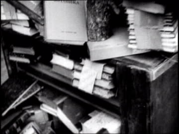 vídeos y material grabado en eventos de stock de russian soldiers going through piles of books outside of church. russians capture baltic seaport on april 01, 1945 in konigsberg, russia - raw footage