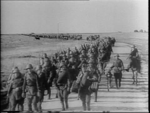 russian soldiers march down don river passing evidence of past battles against nazis since hitler broke the molotov-ribbentrop pact / peasant woman... - 1942年点の映像素材/bロール