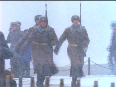 3 Russian soldiers marching during snowstorm by Lenin's Tomb / Moscow