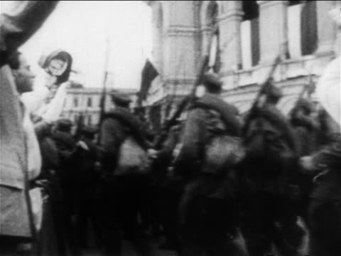 Russian soldiers marching past cheering crowd to RussoJapanese war / documentary