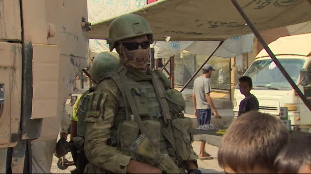russian special forces soldiers keeping guard over a market in deir ez-zor, syria - russia stock videos & royalty-free footage