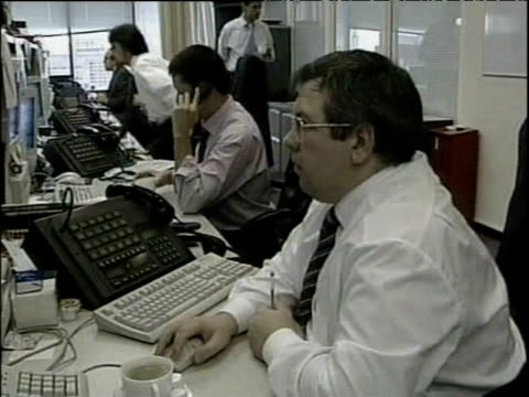 stockvideo's en b-roll-footage met russian stockbrokers working at computer screens and on telephones russia - 1999
